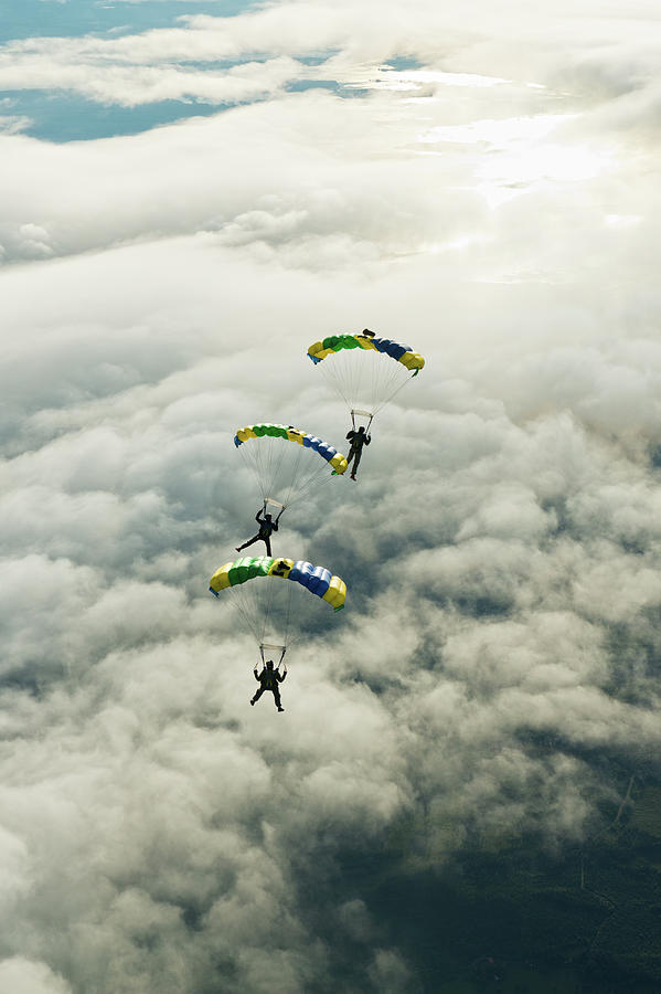 Skydivers In Mid-air Photograph by Johner Images