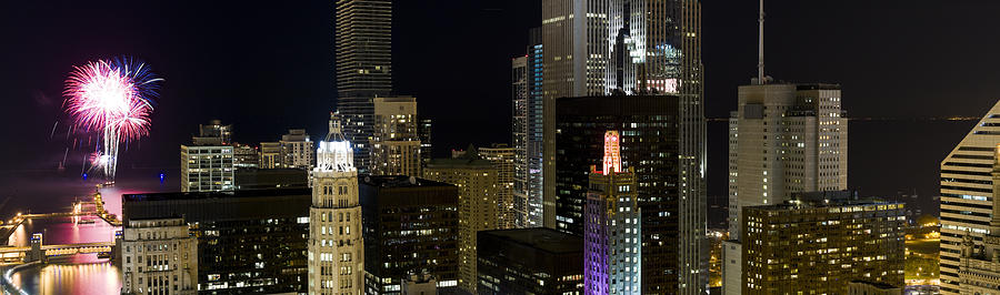 Color Image Photograph - Skyscrapers And Firework Display by Panoramic Images