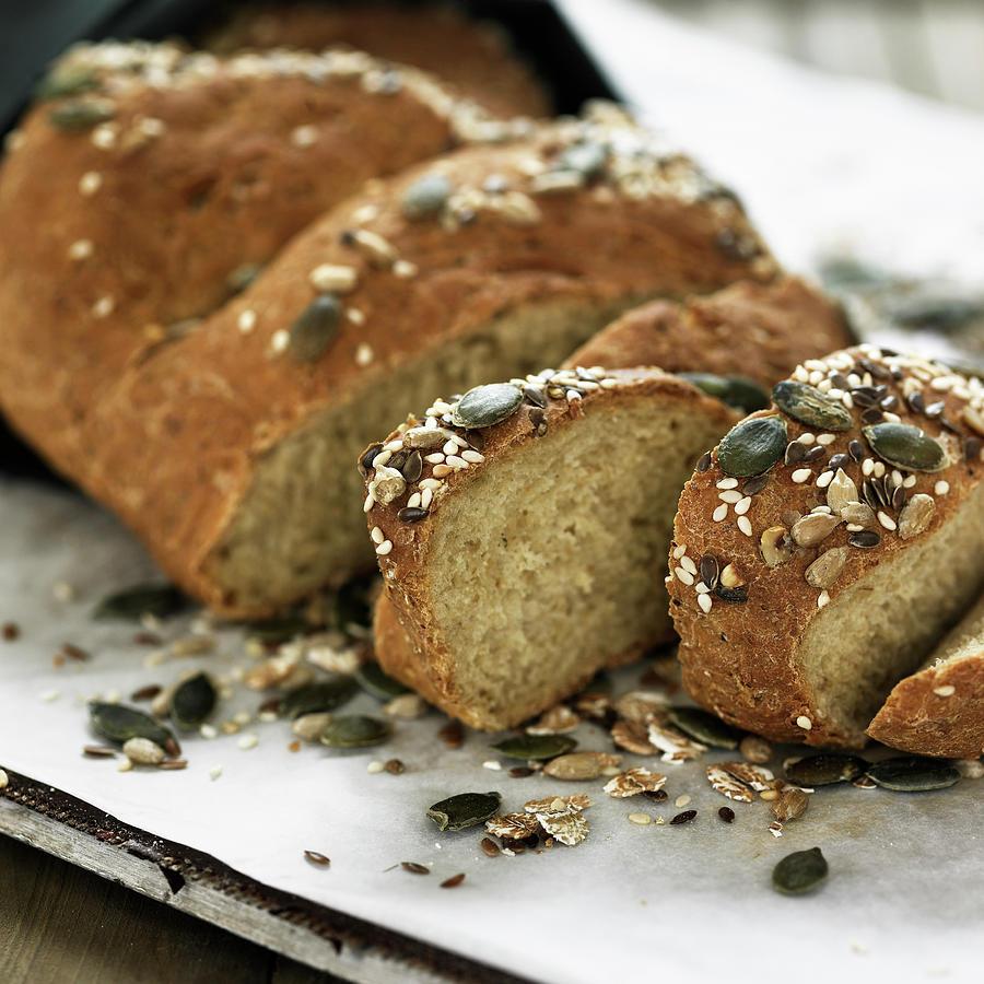 Sliced Whole Grain Bread On Board Photograph by Lisbeth Hjort