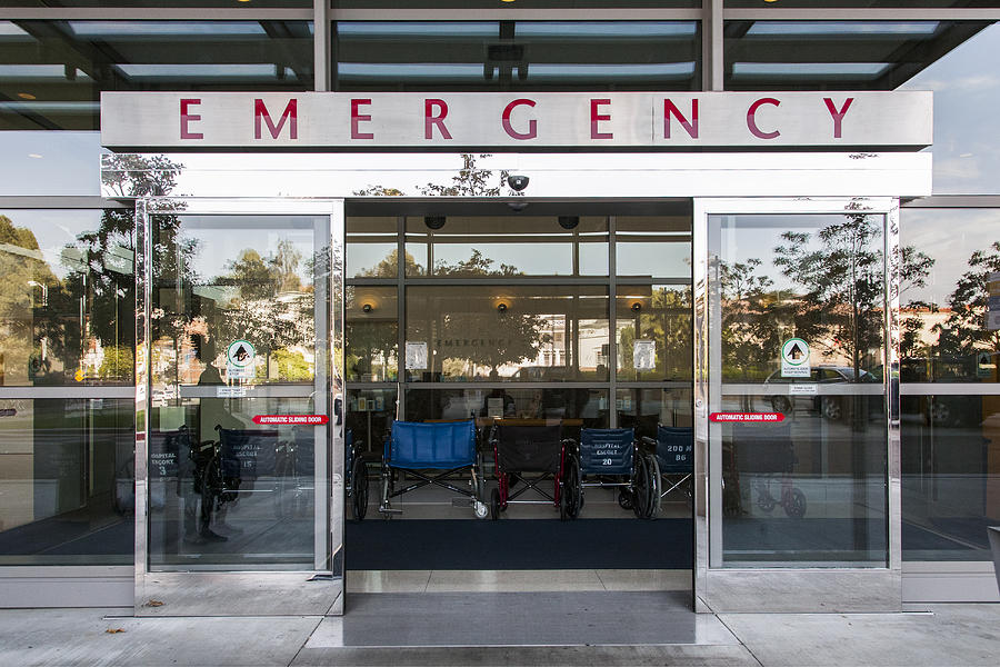 Sliding doors of emergency room in hospital Photograph by Studio 642