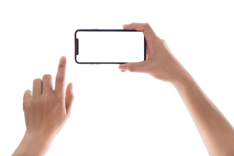 Smartphone in female hands taking photo isolated on white blackground Photograph by Issarawat Tattong