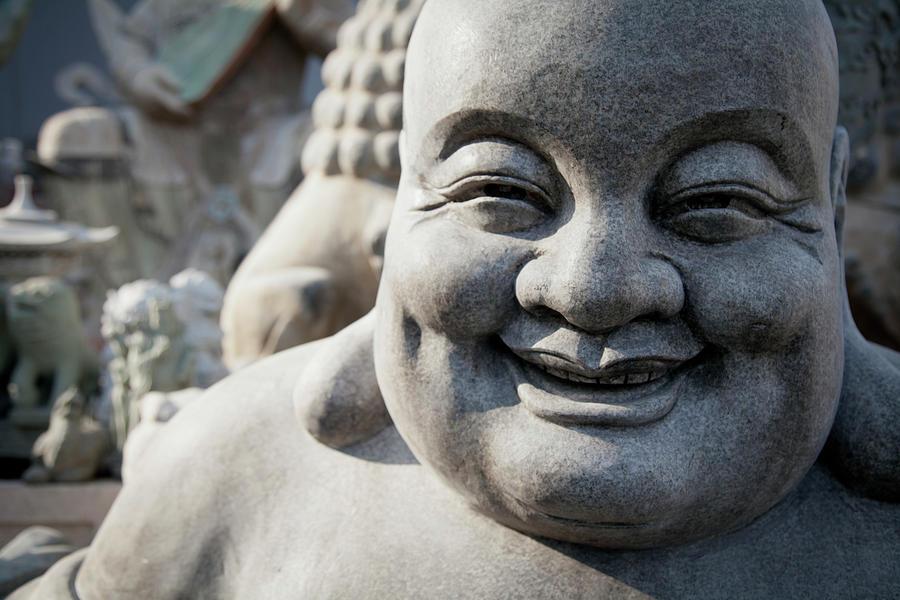 Smiling Stone Buddha Statue Photograph by Blake Kent / Design Pics