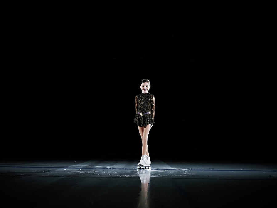 Smiling Young Female Figure Skater Photograph by Thomas Barwick