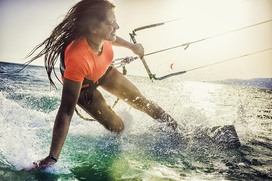 Smiling Young Female Kiteboarder On The Sea Photograph by Vm