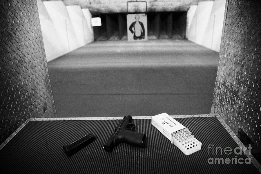 Shooting Photograph - Smith And Wesson 9mm Handgun With Ammunition At A Gun Range In Florida by Joe Fox