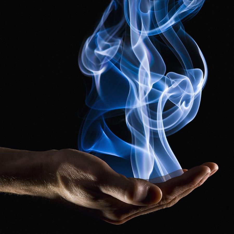 Ethereal Photograph - Smoke Wisps From A Hand by Corey Hochachka