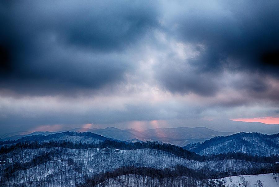 Snow Photograph - Smoky Sunset by John Haldane