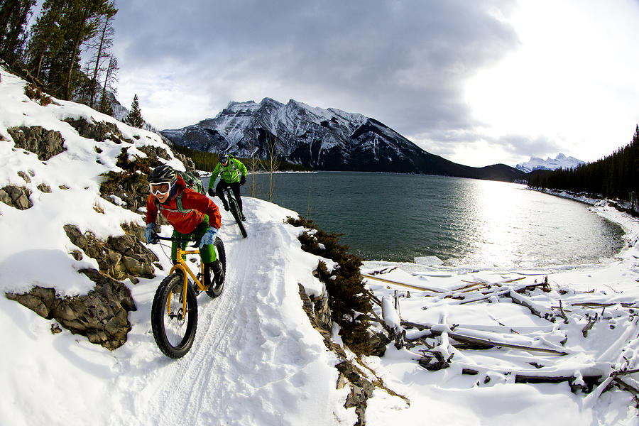 Snow Biking Couple Photograph by GibsonPictures