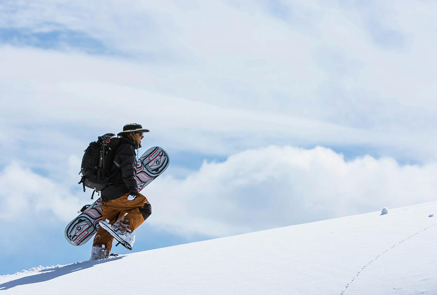Young Men Photograph - Snowboarder Hiking by Ben Girardi