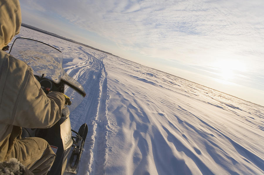 Adventure Photograph - Snowmachiner Following Trail On Frozen by Kevin Smith