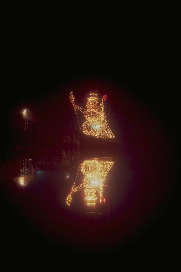 Photo Photograph - Snowman In Lights by Eb Guenther