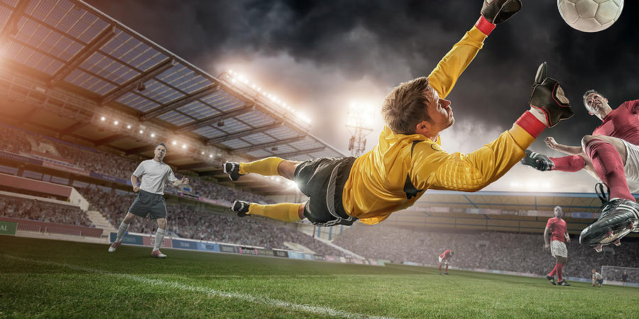 Soccer Goalie In Mid Air Save Photograph by Peepo