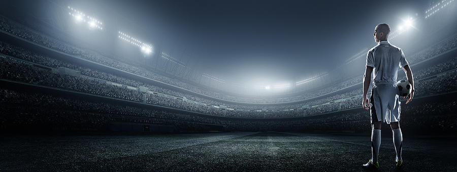 Soccer Player With Ball In Stadium Photograph by Dmytro Aksonov
