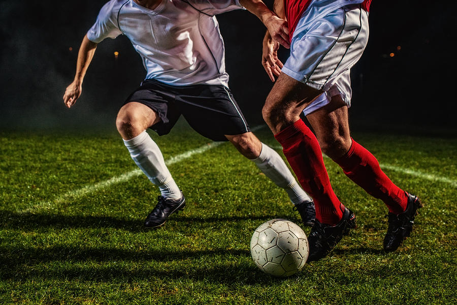 Soccer Players in Action Photograph by Vm