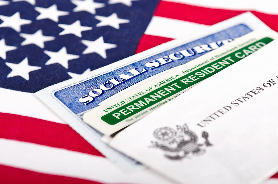 Social Security card and permanent resident on USA flag Photograph by Leekris