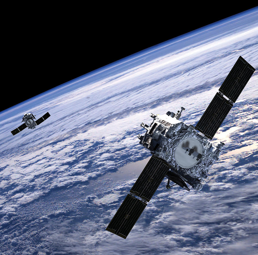 Satellite Photograph - Solar Terrestrial Relations Observatory Satellites by Anonymous