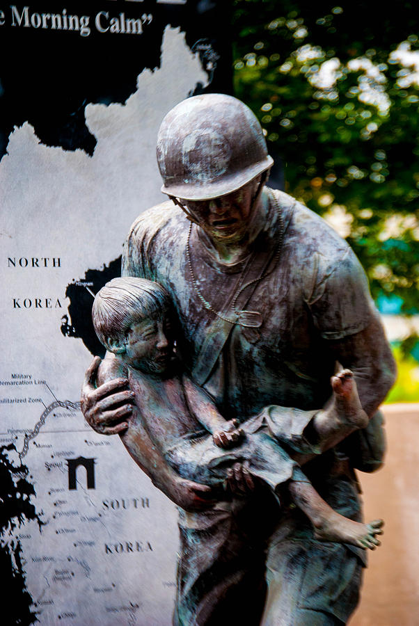 Soldier Carrying Child Photograph By Jon Cody