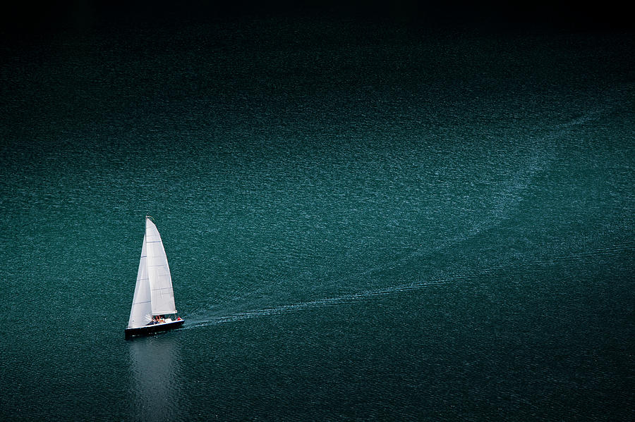 Solo Yacht Cruises On Lake At St. Moritz Photograph by Charles Briscoe-knight