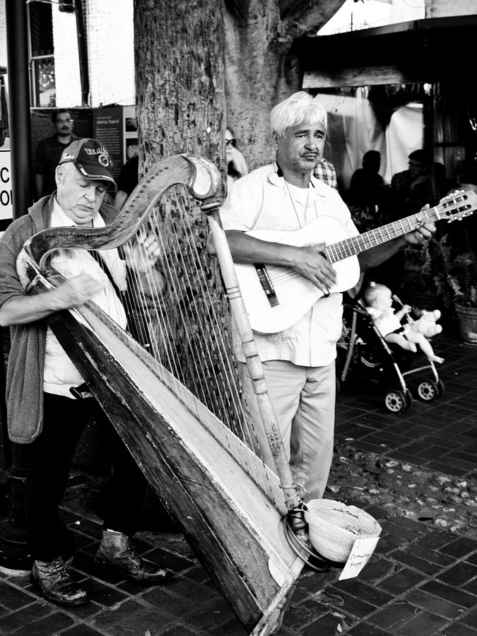 Street Photography Photograph - Sound Of The Streets by Andrew Raby