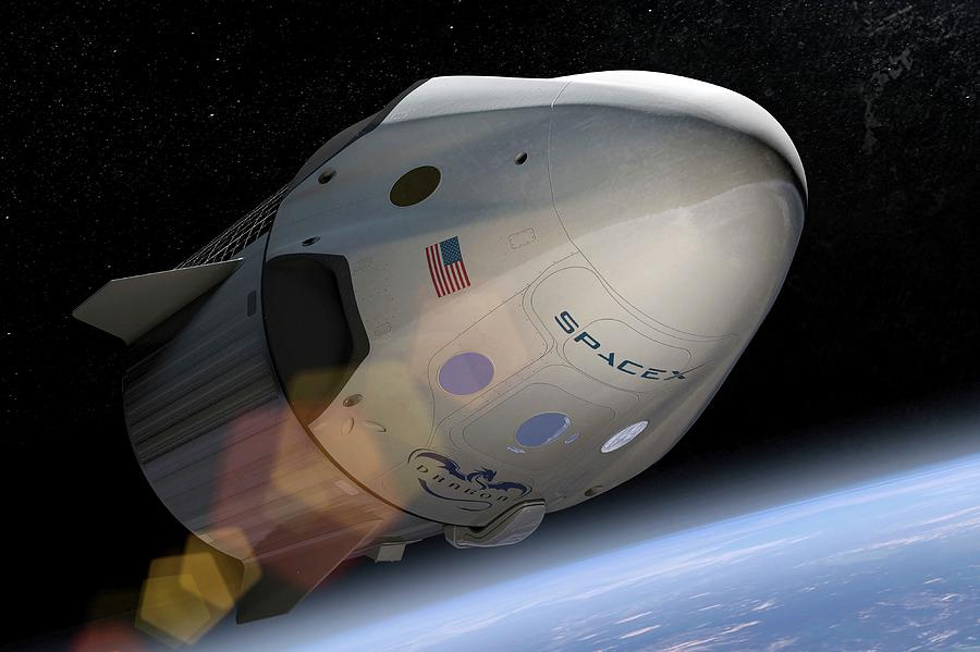 Spacecraft Photograph - Spacexs Crew Dragon In Orbit by Spacex/science Photo Library