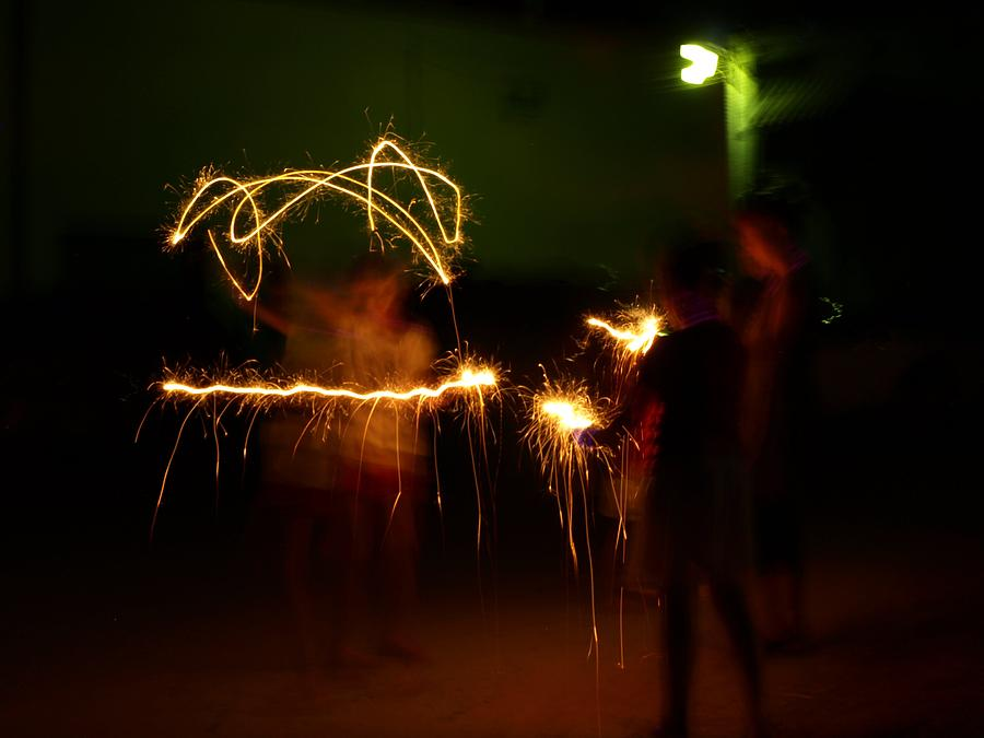 Sparklers Photograph - Sparklers by Valeria Donaldson