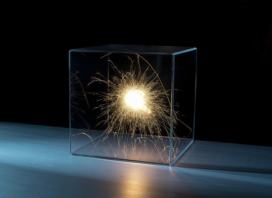 Sparks In A Clear Box Photograph by Pm Images