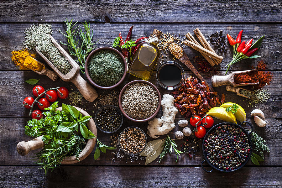 Spices And Herbs On Rustic Wood Kitchen Table Photograph by Fcafotodigital