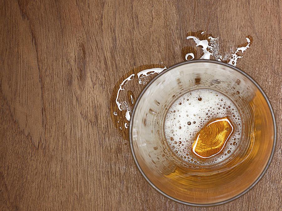 Spilt Beer Photograph by Adrian Burke