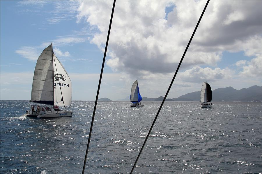 Sailing Photograph - Spinnakers In The Seychelles by Debbie Cundy