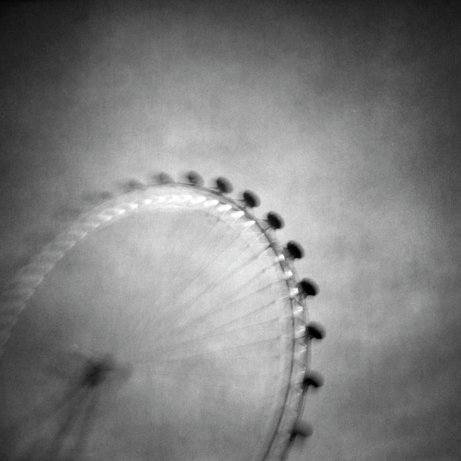 Wheel Photograph - Spinning Round by Vangelis Bagiatis