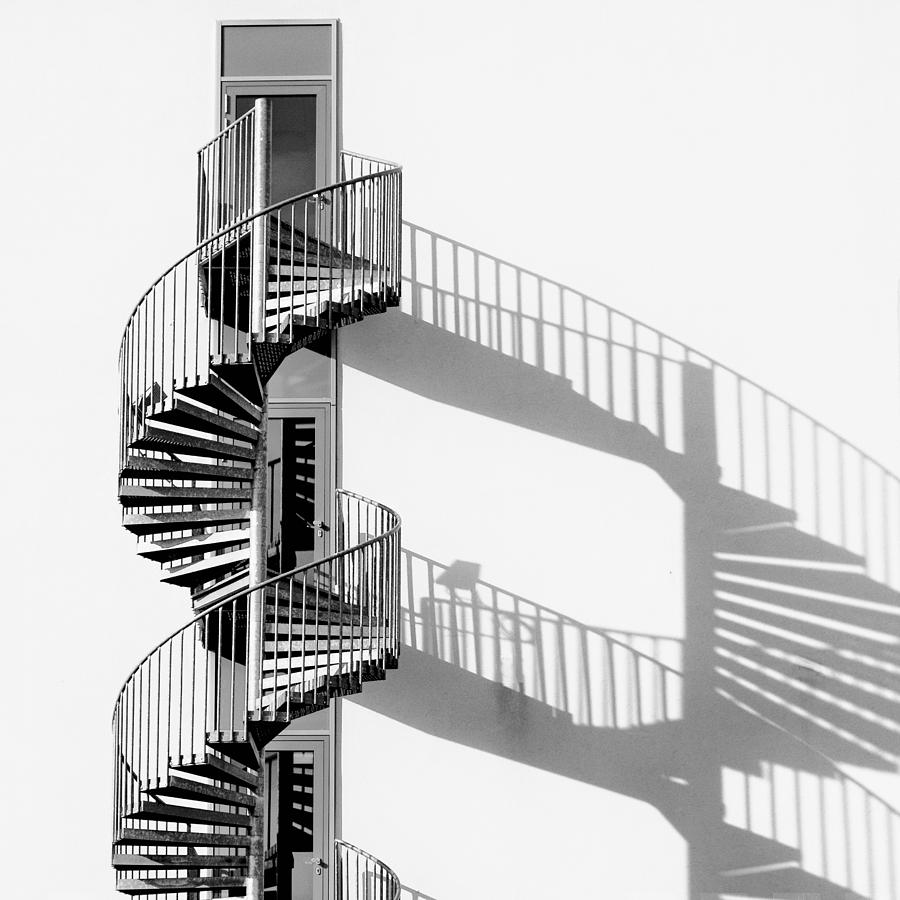 Monochrome Photograph - Spiral Staircase With Shadow by Rainer Czerwonka