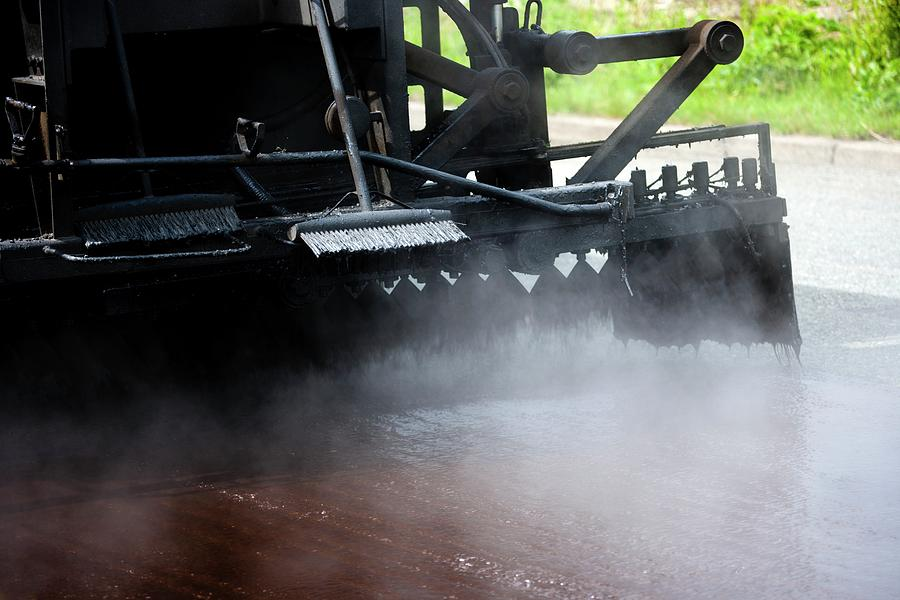 Machine Photograph - Spraying Bitumen During Road Resurfacing by Ian Gowland/science Photo Library