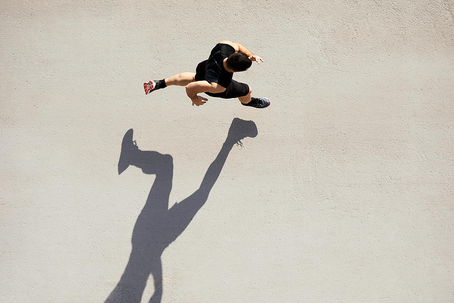Sprinter seen from above with shadow and copy space. Photograph by Tempura