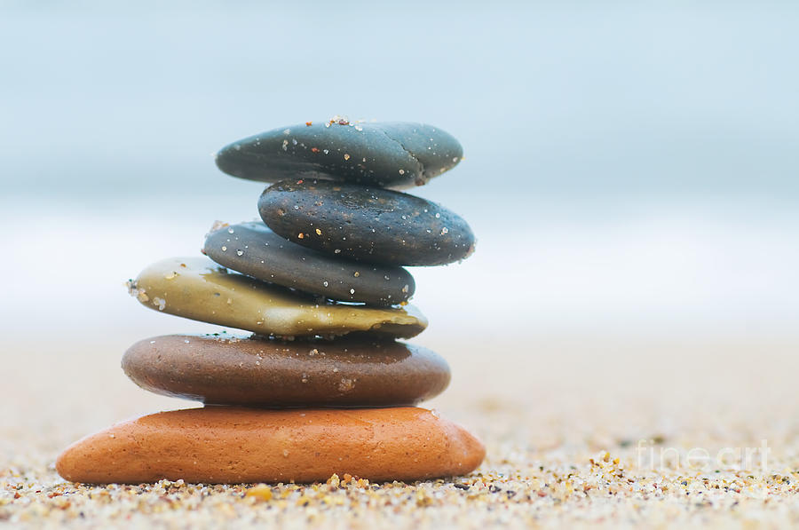 Stone Photograph - Stack Of Beach Stones On Sand by Michal Bednarek