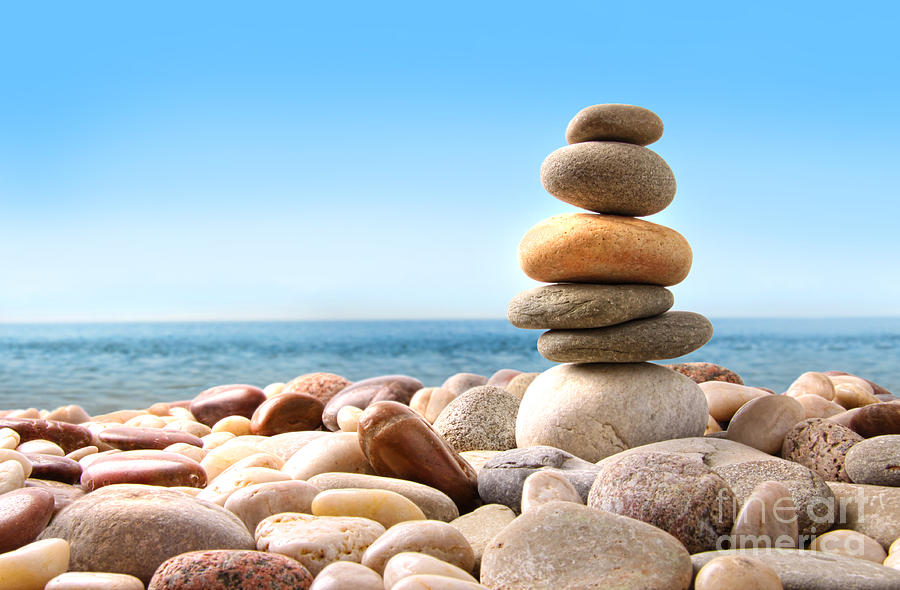 Arrangement Photograph - Stack Of Pebble Stones On White by Sandra Cunningham