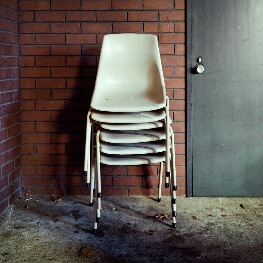 Stack Of Plastic Chairs Photograph by John Abbate