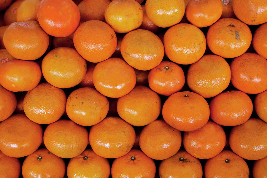 Stack Of Red And Glossy Oranges Photograph by Frank Rothe