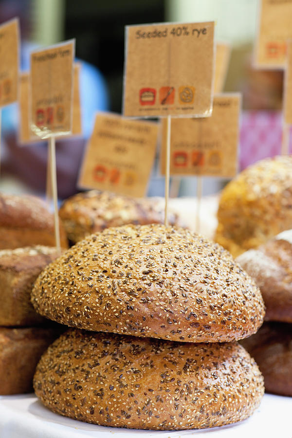 Stacks Of Fresh Bread For Sale Photograph by Hybrid Images