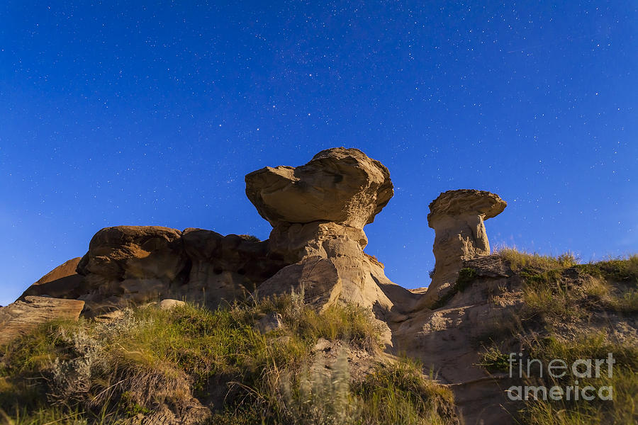 Alberta Photograph - Starry Sky Above Hoodoo Formations by Alan Dyer