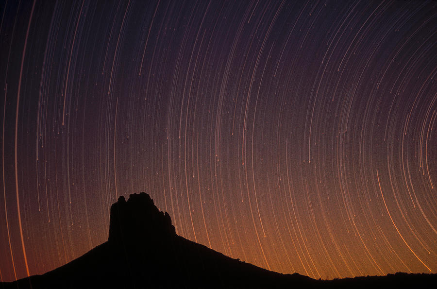 Blurred Motion Photograph - Startrails Over Shiprock In The Four by Tim Fitzharris