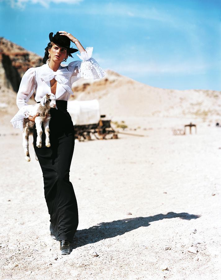 Stella Tennant Carrying A Lamb Photograph by Arthur Elgort