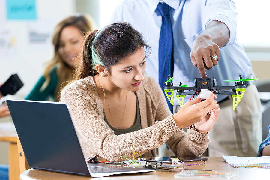 STEM high school student works on drone in class Photograph by Steve Debenport