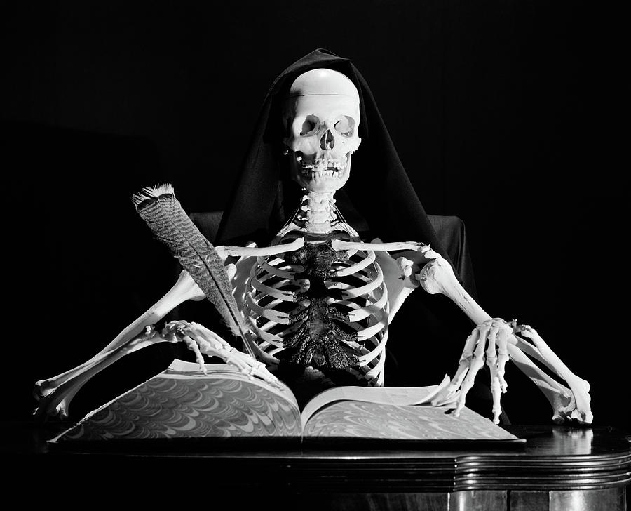 still-life-of-skeleton-writing-in-large-