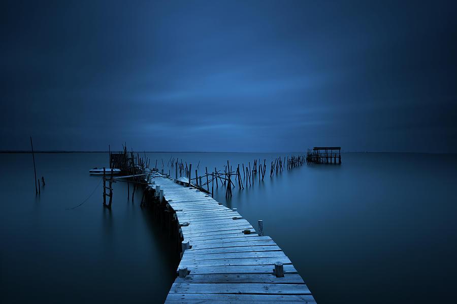 Calm Photograph - Stilts by Miguel Moreno