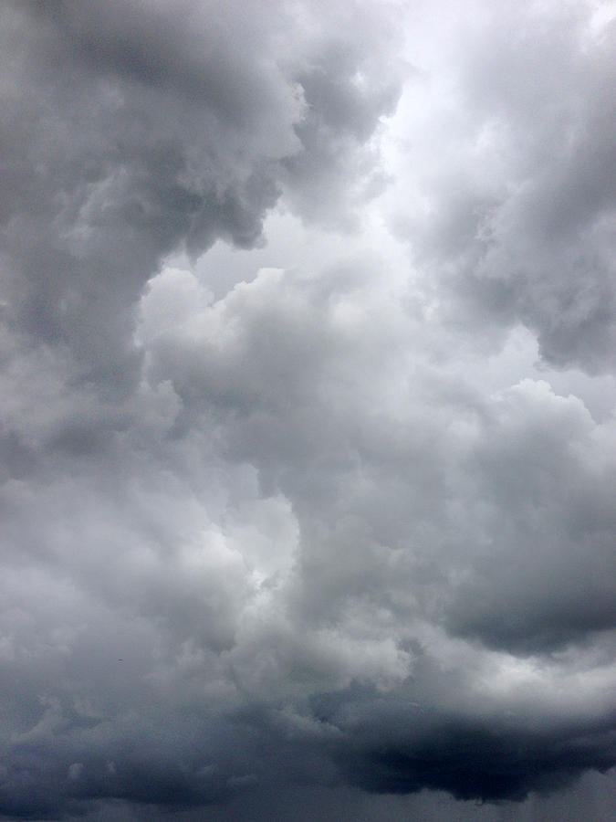 Vertical Photograph - Storm Clouds by Les Cunliffe