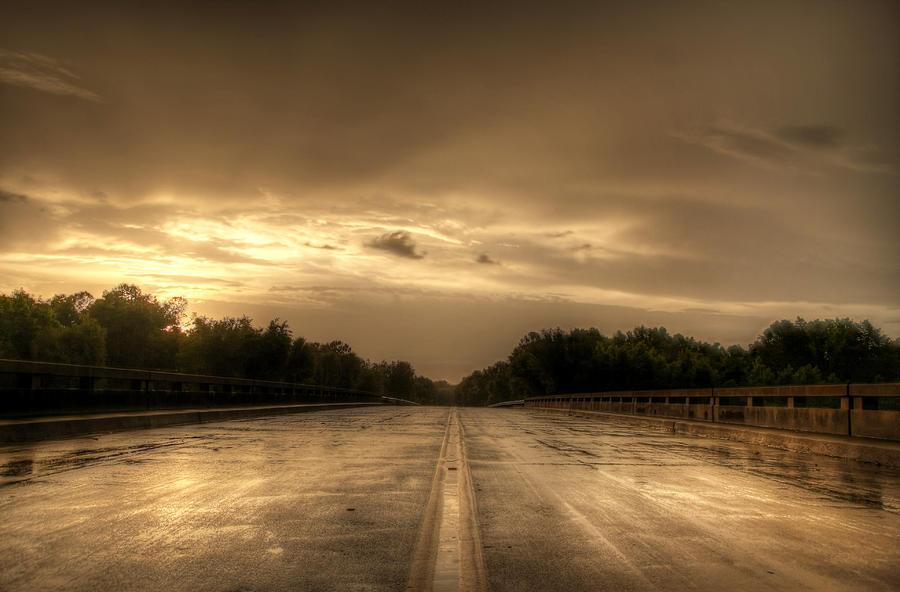 Sunset Photograph - Stormy Bridge by David Paul Murray