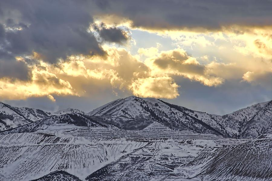 Storm Clouds Photograph - Stormy Sunset Over Snow Capped Mountains by Tracie Kaska