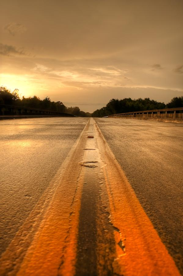 Sunset Photograph - Stormy Yellow Lines by David Paul Murray
