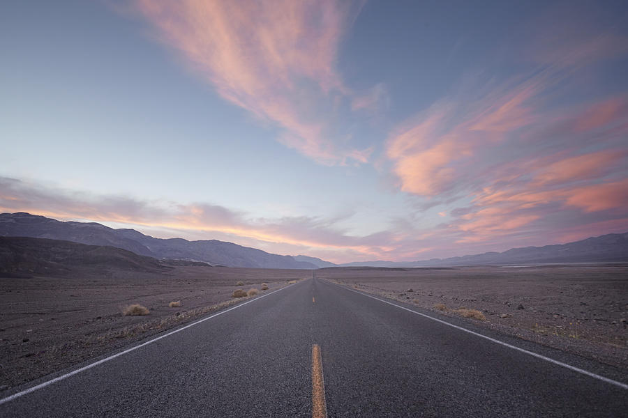 Straight Road In Desert At Sunset Photograph by James ONeil
