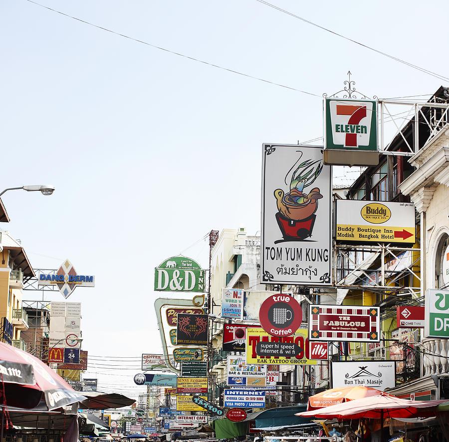 Street Advertising In Bangkok Photograph by Niels Busch